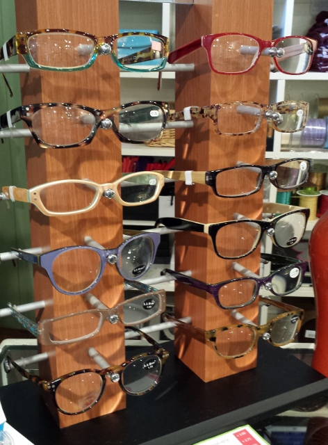 Reader Glasses On The Stand